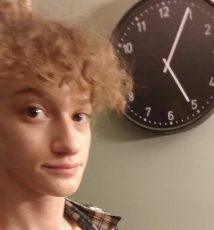 Me in front of a clock